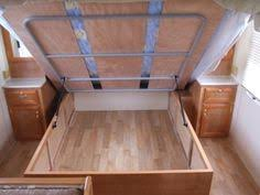 Build Platform Bed Storage Underneath by Star Secrets To Cleaning And Organizing Bed Storage Televisions