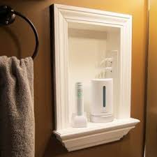 bathroom medicine cabinets with electrical outlet remove medicine cabinets and add a built in shelf and put an