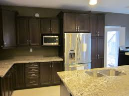 dark oak cabinets with light granite countertops leggo kitchens