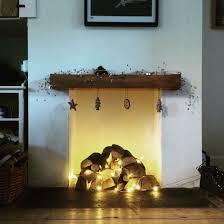 christmas fireplace logs and fairy lights christmas ideas