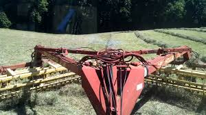 raking hay new holland tn95da and 216 twin rake youtube