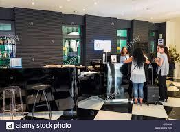 lisbon portugal rua alexandre herculano holiday inn express liberdade hotel lobby front desk reservations woman