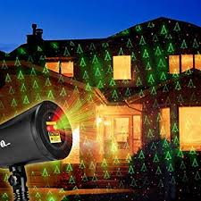 christmas tree laser lights christmas laser lights with green christmas tree and red stars