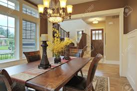 large dining room with wood floors and area rug stock photo