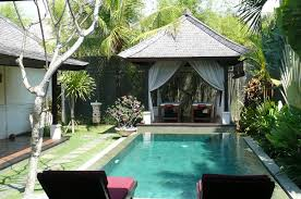 bali style interior design thached roof wooden floor soft blue