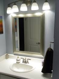 How To Install Bathroom Light Fixture by Bathroom Cabinets Astounding Bathroom Lighting Over Mirror How