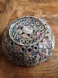 outside of the fruit bowl made out of recycled rolled news paper