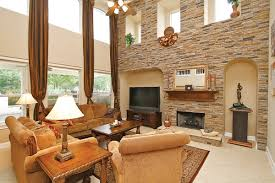 for two story window treatments living room traditional with