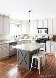 painting kitchen cabinets from wood to white tips for painting kitchen cabinets risenmay