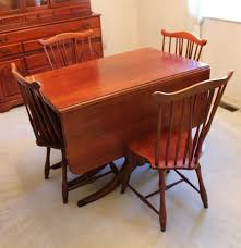 duncan phyfe style cherry dining table and four dining chairs ebth