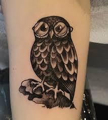 black ink owl tattoo on men bicep black owl tattoos for men