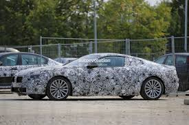 cars bmw 2020 2020 bmw 8 series makes spyshot debut tries to hide its big hips