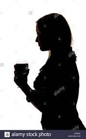 wine silhouette a silhouette of a woman drinking a glass of red wine stock photo