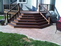splayed trex composite deck stairs onto stamped concrete patio