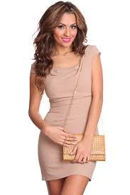 beige sleeveless ruched neckline form fitting dress