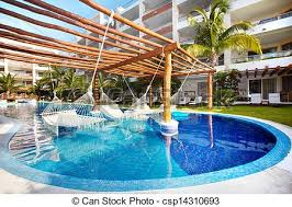 stock photographs of swimming pool and hammock luxury exotic