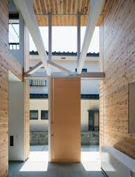 design protrudes timber volume from traditional japanese home