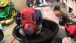 changing the oil on a husqvarna 224l 4 stroke trimmer youtube