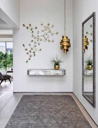 vortex chandelier and trevose mirror by porta romana interiors by