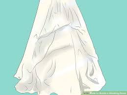 wedding dress bustle 3 ways to bustle a wedding dress wikihow