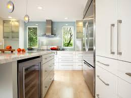 white modern kitchen cabinets and gold brass modern drawer pulls