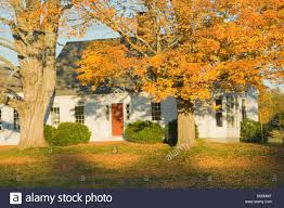 cape cod style house fall maine stock photo royalty free image