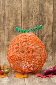 yarn wrapped pumpkin lanterns mum in the madhouse