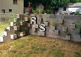 get enchanting atmosphere with awesome cinder block garden ideas