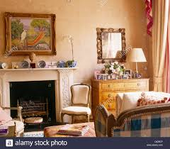 painting above fireplace in comfortable living room with stock