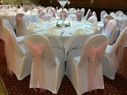 white wedding chair covers marvelous white chair covers with pale pink organza sashes at a