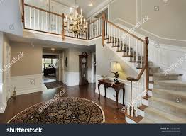 carpeted dining room foyer luxury home carpeted stairs stock photo 553185748 shutterstock