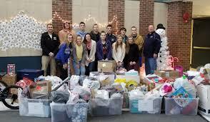 athletics donates presents for adopt a families east greenbush csd