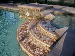 custom chipped mosaic tile spillways for terraced spa spillway