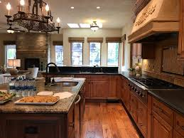 what color cabinets go with black granite countertops how to match granite countertops with your kitchen cabinets
