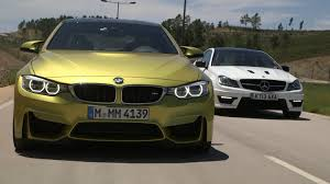 performance coupes go head to head bmw m4 vs mercedes benz c63