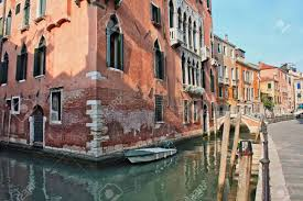 a home in venice on the water with a boat outside the door stock