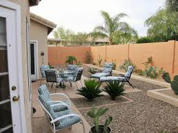 traditional landscape and yard with raised beds u0026 fence in