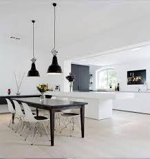 black pendant industrial lighting fixtures over dining area