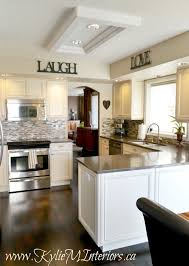 kitchen makeover cream glazed cabinets and grant beige walls and