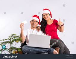 young indian couple red santa hat stock photo 343547105 shutterstock