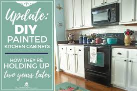 white kitchen cabinets yes or no update on our diy white painted kitchen cabinets 2 years later
