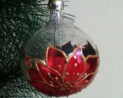 painted clear glass globe ornaments poinsettia outlined in