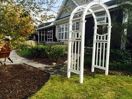 garden arch u0026 stone walkway