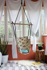 chairs that hang from ceiling a way to have fun with something