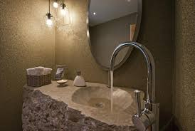 unusual bathroom design for small space with stone wall and