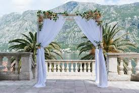 wedding ceremony arch arch for the wedding ceremony decorated with cloth flowers and