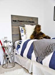 star wars bedroom ideas with bedding and quote headboard and toys