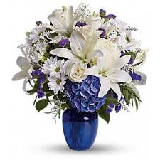 white flower centerpieces in blue flower arrangement