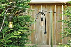 post to hang string lights how to hang string lights garden lights and outdoor lighting