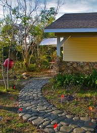 making a wonderful garden path ideas using stones amaza design traditional prefab home design with curvy pebble stone garden path ideas and mini red flag ornaments